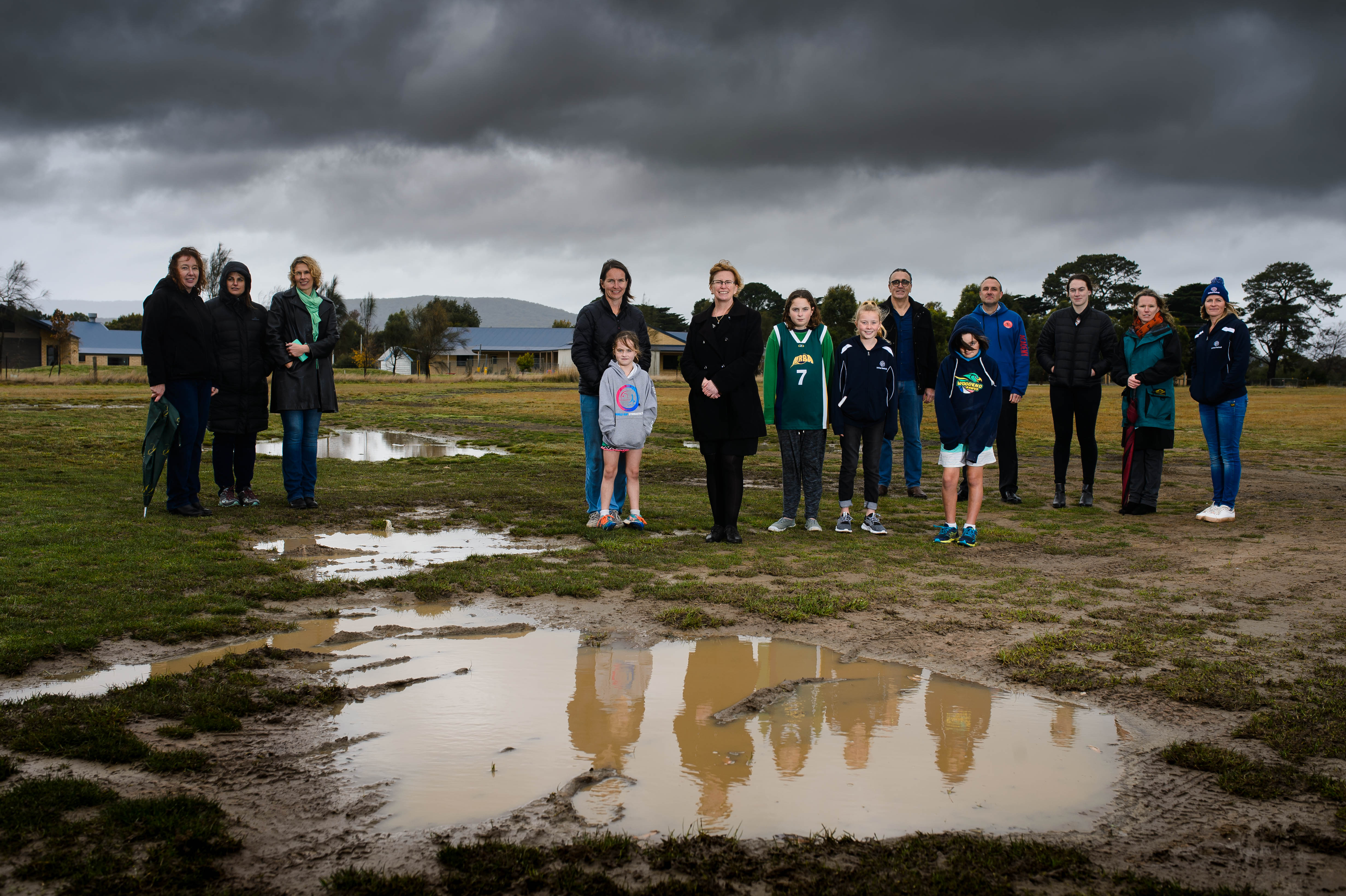 Greens candidate for Northern Victoria Nicole Rowan (centre) on site at the proposed sports precinct location with members of the Macedon Ranges volleyball, netball, basketball and futsal community. Photo: Julian Meehan